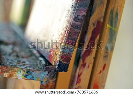 Canvas painting on easel in artists studio