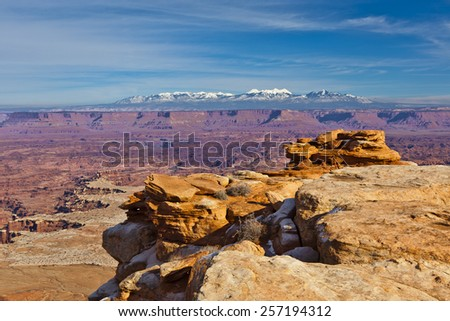 Canyonlands and the snow-capped LaSal Mountains - stock photo