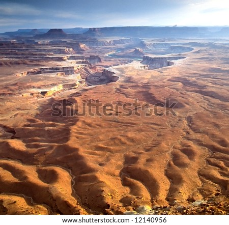 Canyonlands National Park is located in the American state of Utah, near city of Moab and preserves a colorful landscape eroded into countless canyons, mesas and buttes by the Colorado River - stock photo