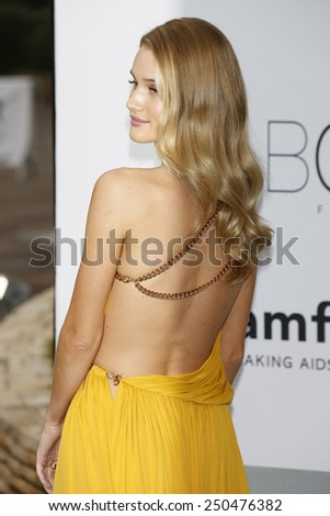 CAP D'ANTIBES - MAY 22: Rosie Huntington-Whiteley at the amfAR's 21st Cinema Against AIDS Gala at Hotel du Cap-Eden-Roc on May 22, 2014 in Cap d'Antibes, France - stock photo