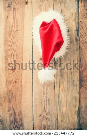 Cap St. Claus attached on a wooden door - stock photo