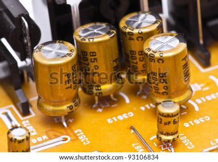 capacitors and electronic components mounted on a motherboard - stock photo