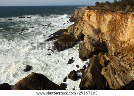 Cape Arago State Park and the sandstone cliffs. - stock photo