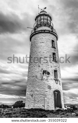 Cape Bruny Lighthouse is located within the South Bruny Island National Park, Tasmania. Black and white picture. - stock photo