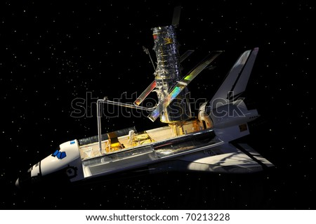 CAPE CANAVERAL, FL- JANUARY 2: The Hubble telescope on Space Shuttle Discovery displayed at NASA, Kennedy Space Center in Florida on January 2, 2011. - stock photo