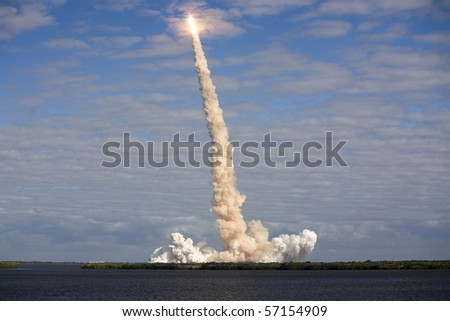 CAPE CANAVERAL, FL - NOV. 16: NASA Space Shuttle Atlantis moves through a cloud after a successful liftoff. on Nov. 16, 2009 at Cape Canaveral, Florida.