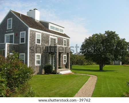 cape cod style house on nantucket island - stock photo