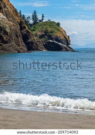 Cape Disappointment Lighthouse in Fort Canby State Park from Waikiki Beach near Ilwaco Washington USA - stock photo