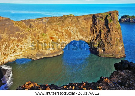 Cape Dyrholaey in southern Iceland. Sunset in July. The colossal rock in the sea in the form of an elephant - stock photo