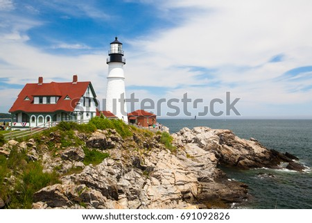 Cape Elizabeth, Maine, USA: July 6, 2016: Portland Head Light (lighthouse) in Cape Elizabeth (Portland suburb), Maine. Situated along the spectacular shores of Fort Williams Park