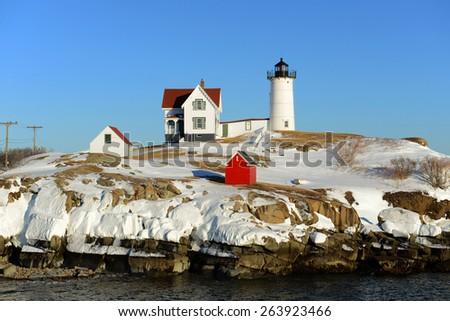 Cape Neddick Lighthouse (Nubble Lighthouse) at Old York Village in winter, Maine, USA - stock photo