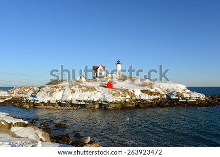 Cape Neddick Lighthouse (Nubble Lighthouse) at Old York Village in winter, Maine, USA - stock photo