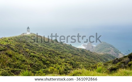 Cape Reinga is the point where the spirits of the dead enter the underworld, which cover by haze - stock photo