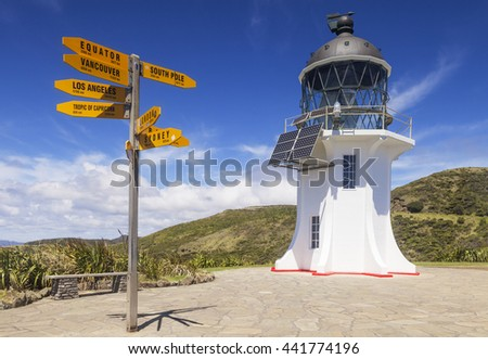 Cape Reinga Lighthouse and world sign post, Northland, New Zealand.