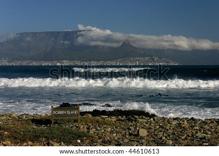 Cape Town and Table mountain seen from the beach of Robben Island - stock photo