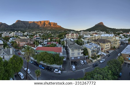 Cape Town's city suburb, known as 'Gardens' in the heart of the CBD, as the sun rises early on a summers morning. Table Mountain, Signal Hill and Lions Head peaks in the background. - stock photo
