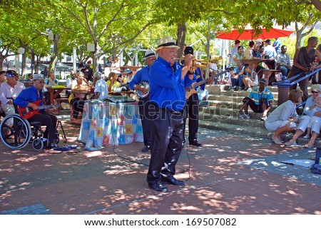 CAPE TOWN, SOUTH AFRICA - DECEMBER 30, 2007: African street jazz band on the Waterfront in Capetown, South Africa. - stock photo