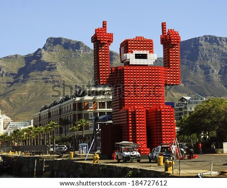 Cape Town, South Africa - December 17, 2010: Elliott the Coca-cola-crate man was made from 4200 crates and stands 18 meters tall at the Victoria and Alfred Waterfront.