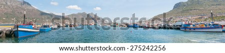 CAPE TOWN, SOUTH AFRICA - DECEMBER 12, 2014:  Panorama of Hout Bay harbor and part of the town - stock photo