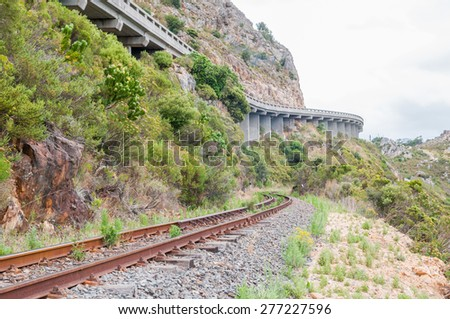 CAPE TOWN, SOUTH AFRICA - DECEMBER 18, 2014: View of the old, unused Railroad in Sir Lowrys Pass in the Hottentots-Holland Mountains near Somerset West. The road pass is visible above.