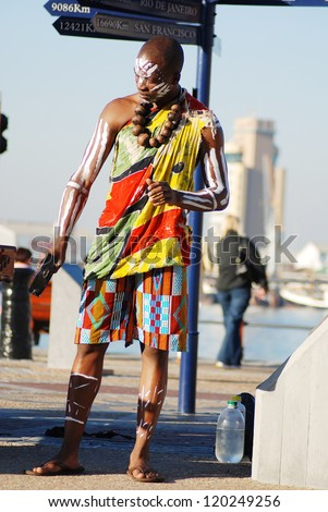CAPE TOWN, SOUTH AFRICA - MAY 25 : An unidentified young man wears traditional clothing, during presentation of a Zulu show on May 25, 2007 Cape Town, South Africa - stock photo