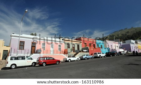 CAPE TOWN, SOUTH AFRICA - MAY 1: City worker's cars parked in Wale Street in Bo Kaap, a district formerly known as the Malay Quarter, in Cape Town, South Africa, on May 1, 2013. - stock photo