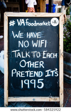 Cape Town, South Africa - November 15, 2016: A board in front of the foodmarket of the V and A waterfront Cape Town is announcing that there is No WiFi and suggests to talk to each other like it is