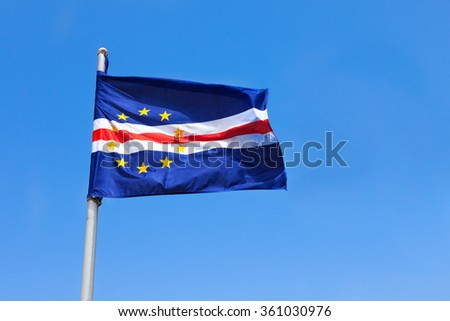 Cape verde flag waving on wind over a blue sky
