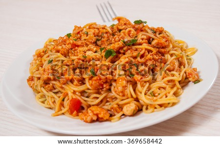 capellini pasta with tomato and meat sauce - stock photo