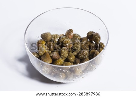 Caper in glass bowl - pizza ingredient - stock photo