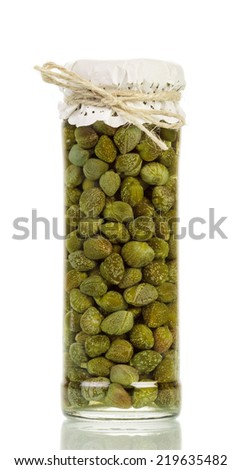 Capers in jar isolated on white background - stock photo