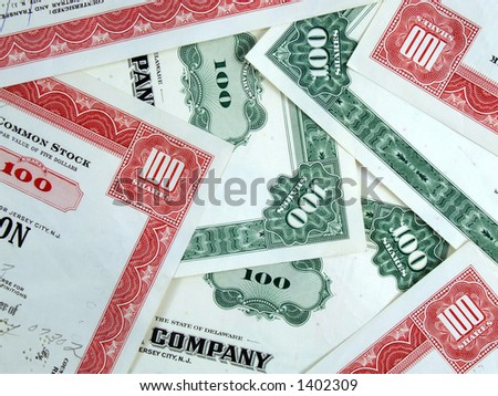Capital stock certificates. Red and green share certificates. Bull & bear - stock market. Old, vintage, retro shares. Common stock & bonds. - stock photo