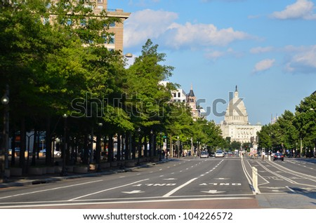 Capitol building from Pennsylvania Avenue with car traffic foreground - Washington DC United States - stock photo