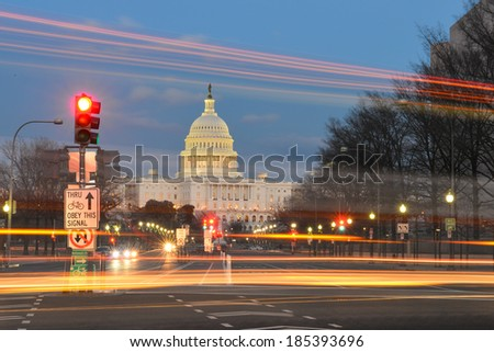 Capitol building night view from Pennsylvania Avenue with car lights trails - Washington DC, United States  - stock photo