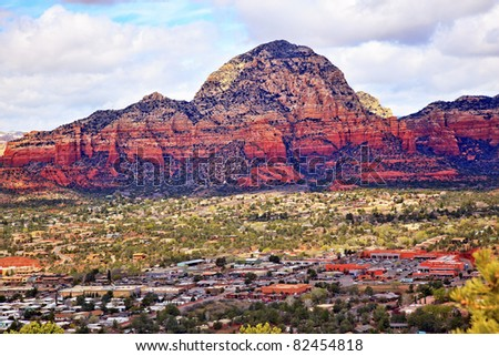 Capitol Butte Orange Red Rock Canyon Houses, Shopping Malls, Blue Cloudy Sky Green Trees Snow West Sedona Arizona - stock photo