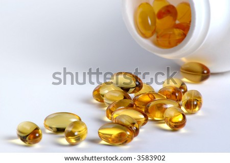 Caplets with a bottle - stock photo