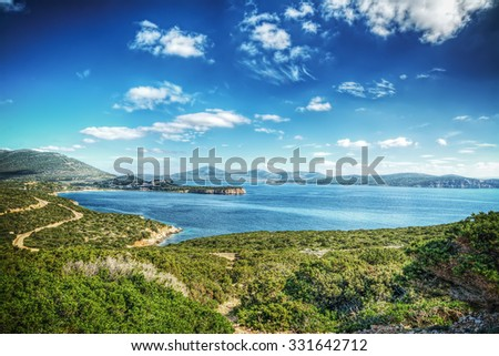 Capo Caccia bay on a cloudy day, Italy