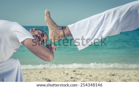 capoeira kick and parry. concept about sport and martial arts - stock photo