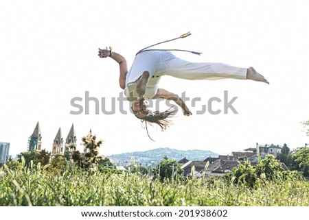 Capoeira woman, awesome stunts in the outdoors - stock photo
