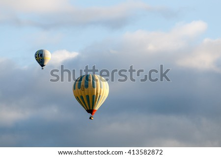 Cappadocia, Goreme Anatolia Turkey. June 2015. Hot air balloon flying over Cappadocia in Turkey. Blue sky and cloud.