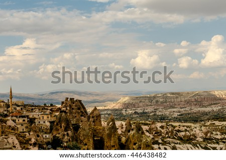 Cappadocia, Goreme Anatolia  Turkey. Pigeon Valley in sunny weather. blue sky and white cloud.