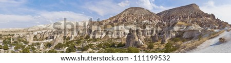 Cappadocia, the famous and popular tourist destination at Turkey, as it has many areas with unique geological, historic and cultural features. - stock photo