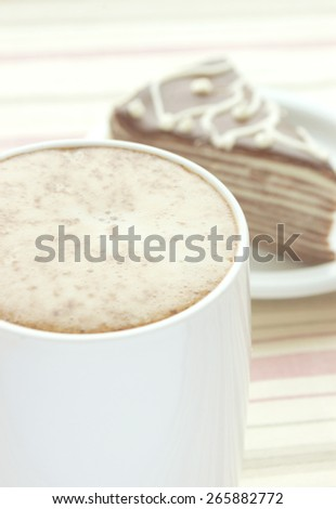cappuccino and cake on the table
