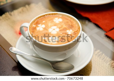 Cappuccino coffe at the table - stock photo