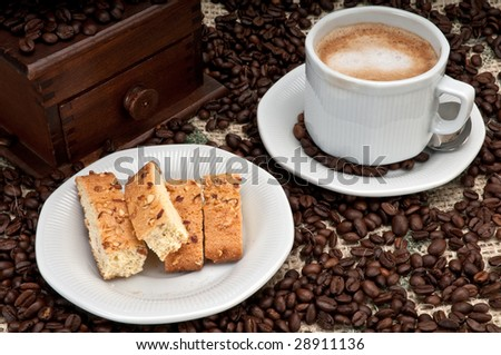 Cappuccino Coffee and italian Biscotti with Almonds and Walnuts - stock photo