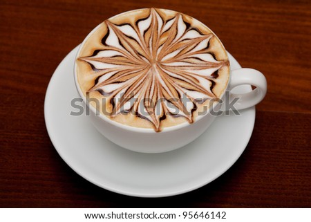 cappuccino,  coffee cup on table - stock photo