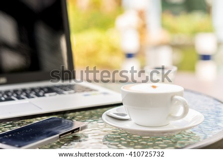 cappuccino coffee cup on table ,soft focus