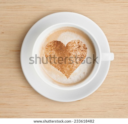 cappuccino coffee cup with foam and heart shape - stock photo