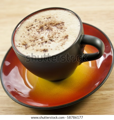 Cappuccino coffee in a brown ceramic cup - stock photo