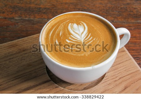 Cappuccino Coffee on the wood plate - stock photo